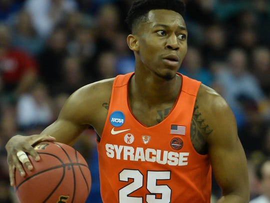 Syracuse Orange guard Tyus Battle (25) dribbles against