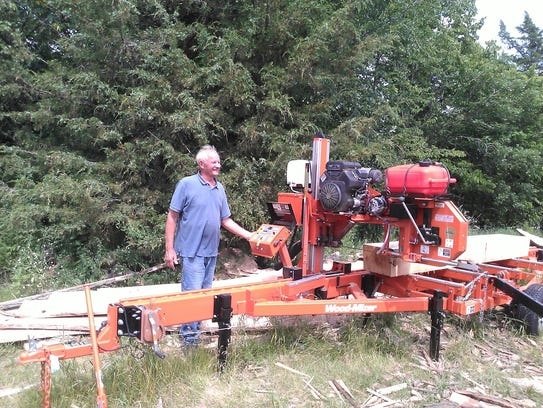 Vern Salzl stands next to his saw rig at Cold Spring.