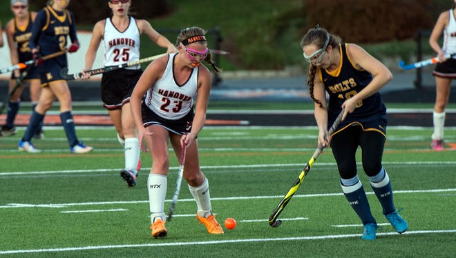Hanover's Maddie Dell goes after the ball against Littlestown's Savannah Schisler, Wednesday, October 25, 2017. The Littlestown Bolts topped the Hanover Hawkettes, 2-1, in overtime during the first round of District 3 playoffs.