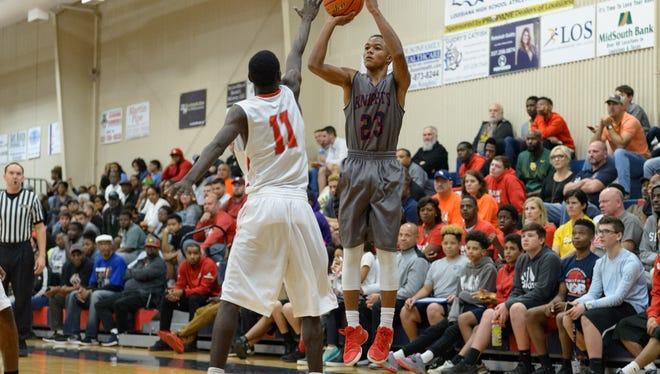 Kailen Thibodeaux shoots a three as LCA takes on West Jefferson basketball. Thursday, Dec. 21, 2017.