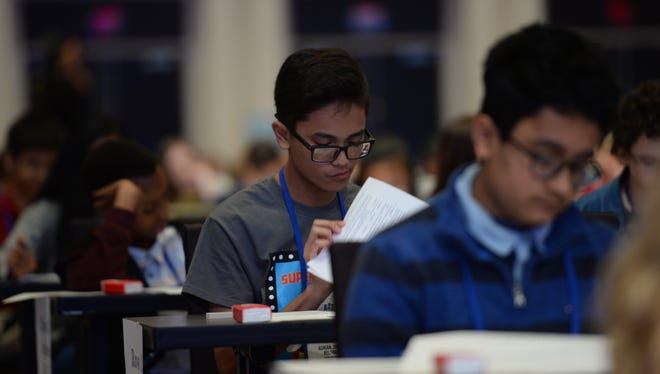 Adrian James Beltran, 13, from Yigo, Guam during the Preliminaries Test during the final round of the 2017 Scripps National Spelling Bee at the Gaylord National Resort and Convention Center. Mandatory Credit: