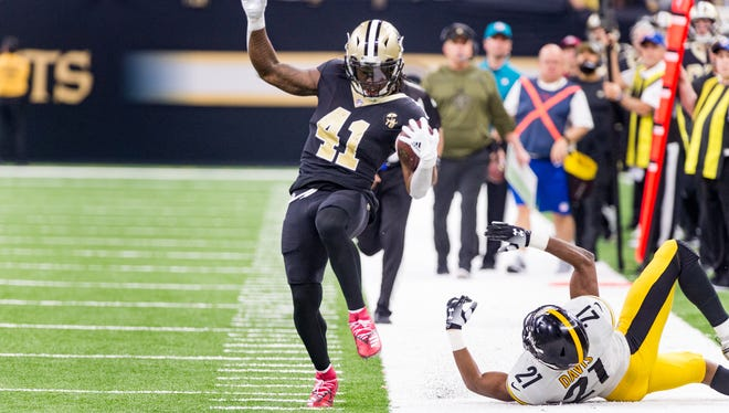 Saints runningback Alvin Kamara runs down the sideline during the  NFL football game between the New Orleans Saints and the Pittsburgh Steelers in the Mecedes-Benz Superdome.. Sunday, Dec. 23, 2018.