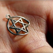 A medallion in the shape of the Star of David is shown after being discovered in the perimeter of a Nazi death camp in Sobibor September 18, 2014.