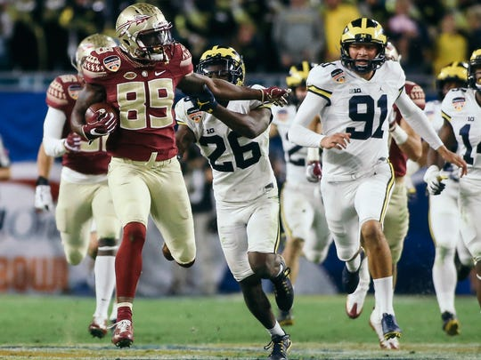 With this 66-yard kick return, Keith Gavin (89) helped spark plug Florida State to a 33-32 victory over Michigan in the Orange Bowl.