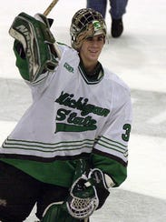 MSU goalie Ryan Miller waves to the crowd after setting