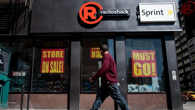 A man walks past a RadioShack storefront in the Chelsea neighborhood of New York