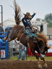 Ryder Wright competes in the saddle bronc event during