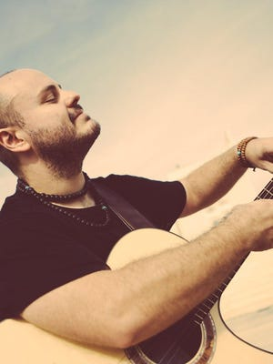 Andy McKee, a Topeka-born and nationally known guitarist, will perform at 7:30 p.m. Oct. 25 at McCain Auditorium at Kansas State University as part of the venue's livestream series McCain Connected.