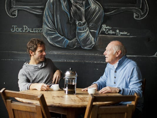 Mike Calabrese, owner of Java's Cafe, chats with coffee roaster Joe Palozzi