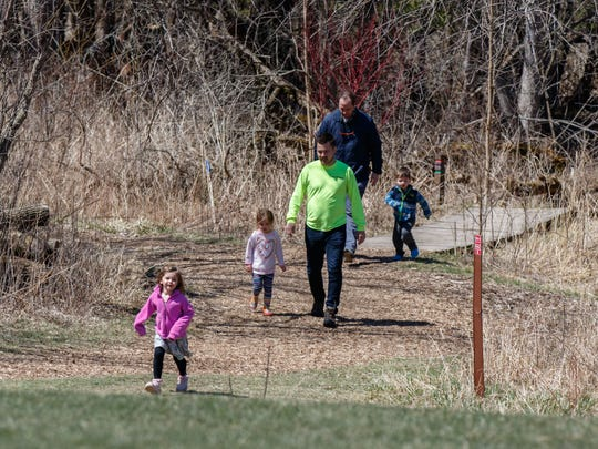 Taking a nature hike is one way to get kids outdoors and active after a long winter.