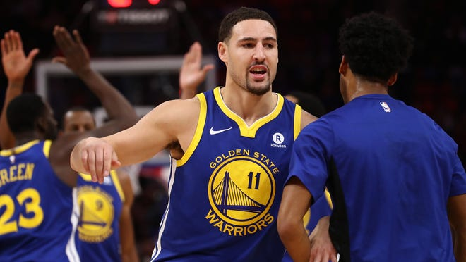 DETROIT, MI - DECEMBER 08: Klay Thompson #11 of the Golden State Warriors celebrates a second half three point basket while playing the Detroit Pistons at Little Caesars Arena on December 8, 2017 in Detroit, Michigan. Golden State won the game 102-98. NOTE TO USER: User expressly acknowledges and agrees that, by downloading and or using this photograph, User is consenting to the terms and conditions of the Getty Images License Agreement. (Photo by Gregory Shamus/Getty Images) ORG XMIT: 775027019 ORIG FILE ID: 888609362