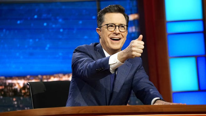 Stephen Colbert behind his 'Late Show' desk.