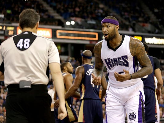 Sacramento Kings center DeMarcus Cousins stares at official Scott Foster after he was called for a foul during the first quarter of an NBA basketball game against the New Orleans Pelicans on Wednesday, Jan. 13, 2016, in Sacramento, Calif. (AP Photo/Rich Pedroncelli)