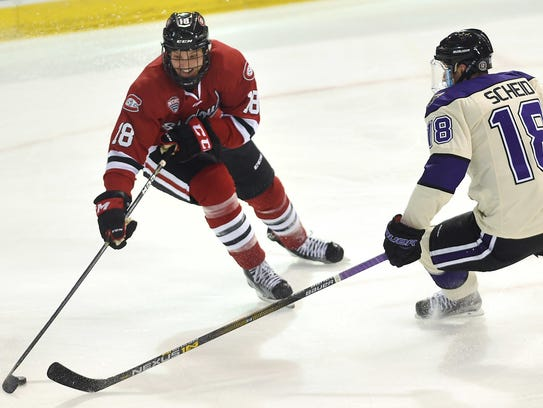 St. Cloud State center Judd Peterson maneuvers the