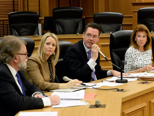 Attorney Jeff Parrish, left; Allison Duke, associate dean of the College of Business at Lipscomb University; legislative attorney Doug Himes; attorney Dianne Neal; and Frank Gibson, public policy director for the Tennessee Press Association, talk during a Tennessee General Assembly sexual harassment policy committee meeting at Legislative Plaza on Thursday, Feb. 18, 2016.