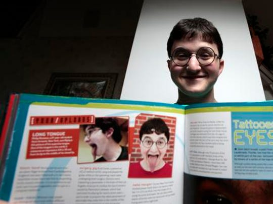 Philip Romano has one of the country's longest tongues and appears in a new Ripley's Believe It or Not book. Romano, 21, is photographed at his home in Armonk Oct. 10, 2014.