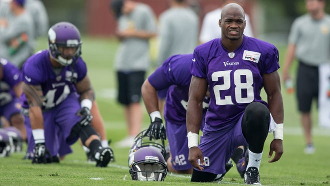Jul 25, 2014; Mankato, MN, USA; Minnesota Vikings running back Adrian Peterson (28) stretches at training camp at Minnesota State University.