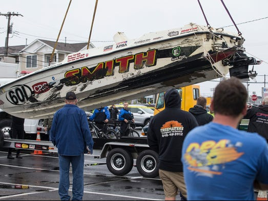Work crews recover the Smith Brothers race boat. After