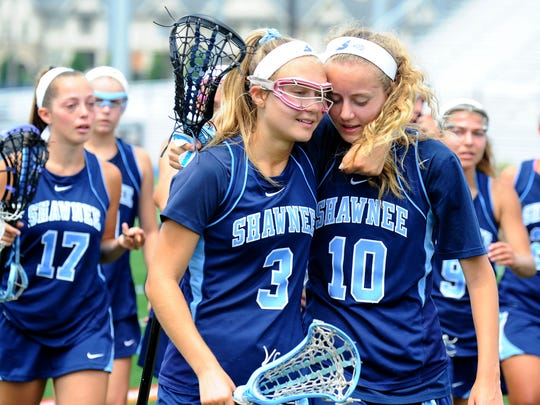Shawnee's Liza Barr, left, hugs her sister Erica after losing to Ridgewood 18-4 in the Group 4 state final on Saturday at Kean University.