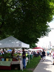 Mann's Country Gardens booth at Wisner Market.
