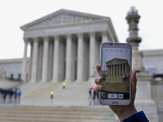 636143789419535795--stockphoto-AP-US-Supreme-Court-Phone-2.jpg