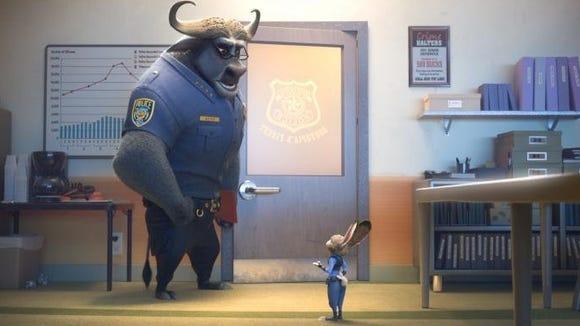 "Chief Bogo (Idris Elba) chastizes Judy Hopps (Ginnifer Goodwin) in a scene from ""Zootopia."""