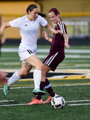 Southeast Polk's Avery Abbas moves the ball down field against Ankeny in a game from 2016.