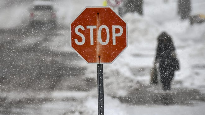 Snow continues to fall Friday, April 12, 2019, in St. Cloud, Minn.