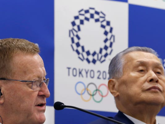 International Olympic Committee (IOC) Vice President John Coates, left, speaks with Tokyo 2020 Olympics President Yoshiro Mori during a joint press conference in Tokyo, Wednesday, Dec. 13, 2017. (AP Photo/Shizuo Kambayashi)
