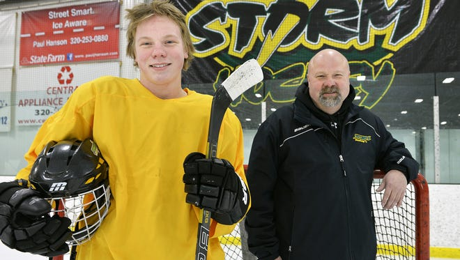 Travis Kothenbeutel (left) with his father, John, when Travis was a junior and John was the head coach of the Sauk Rapids Storm. Travis recently committed to play hockey for the University of Nebraska Omaha and has spent the last two seasons playing junior hockey for the Austin Bruins of the North American Hockey League.