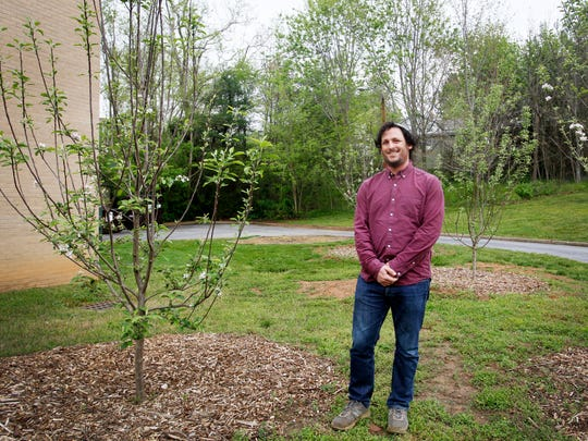 Rabbi Justin Goldstein stands among Congregation Beth Israel's apple trees April 20, 2017.