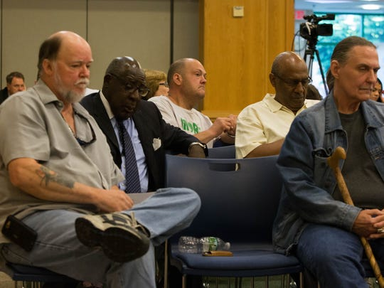 Marijuana legalization advocates listen as a panel against legalization speaks during a roundtable discussion in Wilmington Thursday.