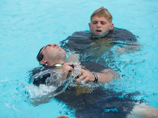 Corpus Christi Police Academy cadets pass around bean bag as they tread water in the Greenwood Pool during their two days of water training on Thursday, Sept. 28, 2017.