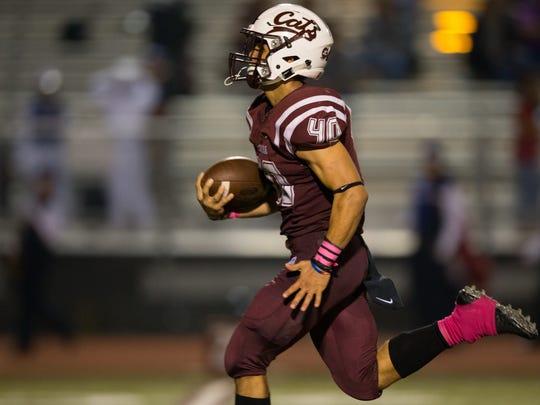 Calallen's Alec Brown runs the ball for a touchdown