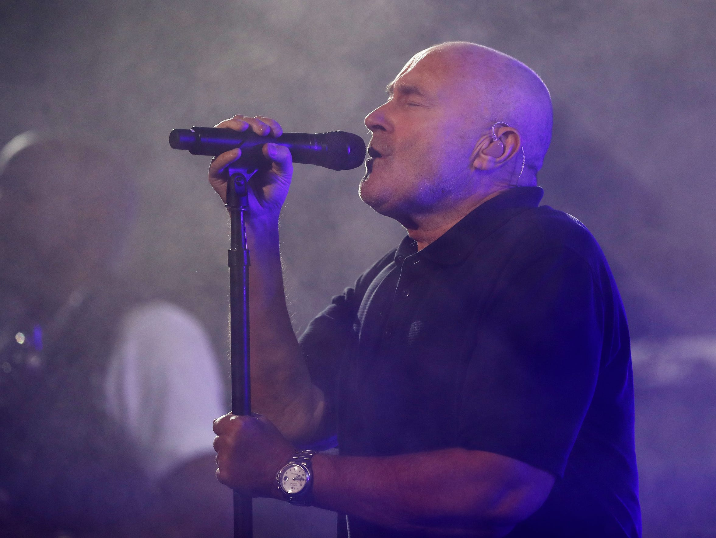 Phil Collins performs on opening night prior to the