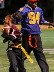 Concord unified athlete Alexis Hubbard has her flag pulled by Caesar Rodney unified partner Marcus Carney.