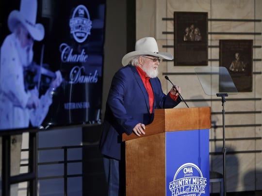 Fiddler Charlie Daniels speaks at a press conference