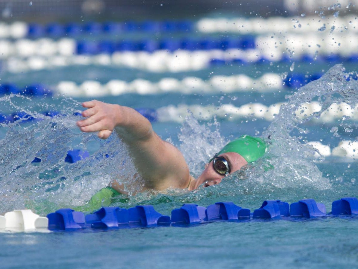 Kendall Brent of Fort Myers High School swims in the Girls 200 Yard Freestyle at the LCAC Championships on Thursday. Brent won the race.