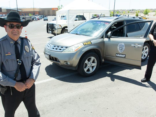 Sgt. Fernando Ravessoud, left, and Lt. Matt Huebert stand near an official New Mexico Mounted Patrol vehicle on Saturday, July 21, 2018 at the Walmart on Rinconada Boulevard during a media event.