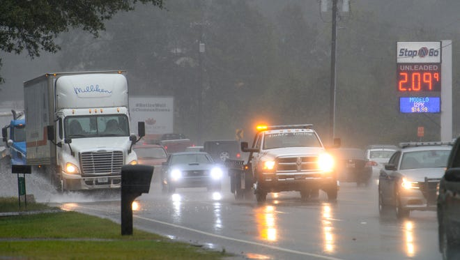 Cars move slowly on U.S. 76  near Sandy Springs, past a collision Monday.
