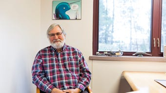 Dr. Fred Eichmiller explains his research on the narwhal tusk in his office at Delta Dental in Stevens Point, Wis., on Monday, October 30, 2017.