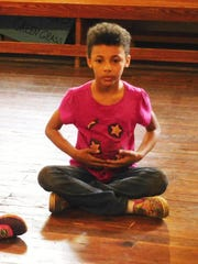 Theater students do a variety of breathing exercises