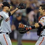 San Francisco Giants starting pitcher Chris Heston (53) celebrates with catcher Buster Posey (28) after throwing a no-hitter against the Mets at Citi Field. The Giants won 5 - 0.