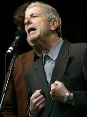 Leonard Cohen sings during a free concert, Saturday, May 13, 2006 in Toronto, Ont.