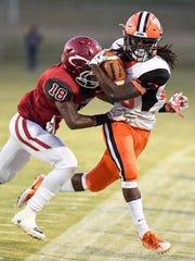 Crockett County's Dennis Buchanan pushes South Gibson's Dre McAllister out of bounds during their game, Friday, September 8.