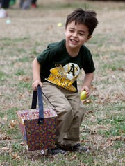 Alexander Bowling picks up eggs Saturday, March 17,