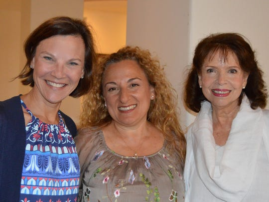 Julie Vargo-O'Brien, left, Tiziana Lahey, and Gloria Xiques at the Spring luncheon of Vero Beach Opera's Amici Society at the Grand Harbor Clubhouse.