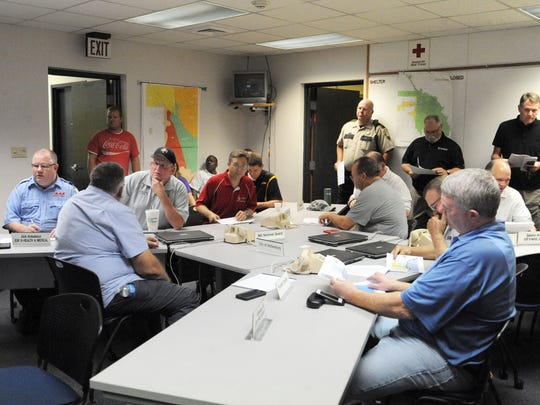 The Forrest County Emergency Management District goes over information about Hurricane Nate on Saturday.