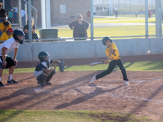 Derek Carrillo of the Pirates makes contact at the