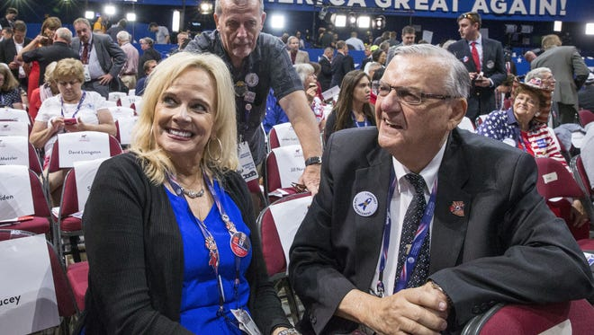 Delegates Elizabeth Alcorn and Sheriff Joe Arpaio on the floor during the Republican National Convention at Quicken Loans Arena in Cleveland, Ohio, on Monday, July 18, 2016.